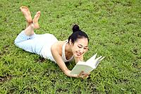 Young Woman Reading Book Outdoor,Korea