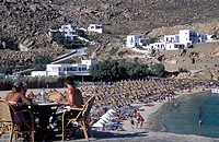 Super Paradise Beach view, people sitting , Mykonos, Cyclades, Greece
