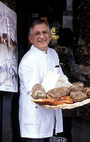 Deli propietor Emilio Volpetti shows off a selection of his cured meat and cheese in Testaccio , Rome, Italy, Europe