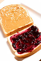Peanut butter &amp; jelly sandwich on white bread