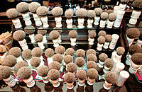 Shaving brushes at men's hairdresser. London. England