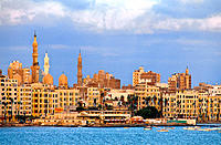 The city skyline from sea at sunrise. Alexandria. Egypt