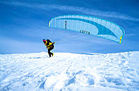 Paraglider pilot taking off. Courchevel, Three Valleys, Savoie, France, Europe