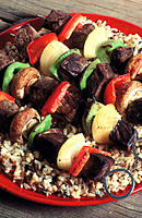 Shish-ka-bob (lamb and vegetables cooked on a skewer) with pilaf (seasoned rice)