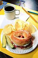 Working lunch, bagel sandwich