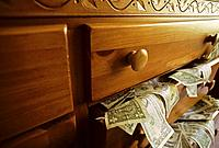 USA money spilling out drawer