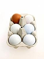 Golf balls in egg carton