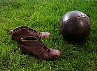 Old soccer ball and shoes