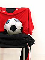 Tricot and soccer ball on chair