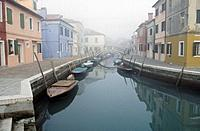 Tranquil canal streetscape in Burano, Venice, Italy