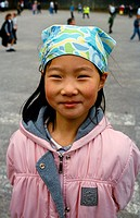 Asian Girl Smiling at Primary School in England