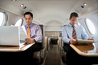 Businessmen Reading on Plane