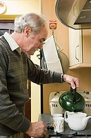 Senior man making tea (thumbnail)