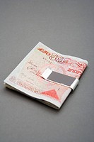 Fifty pound notes in money clip