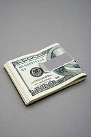 One hundred dollar bills in money clip