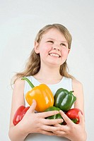 Girl holding peppers (thumbnail)