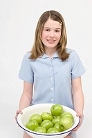 Girl with bowl of apples