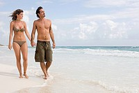 A couple walking along a beach (thumbnail)