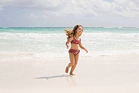 A girl running in the sea