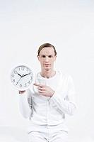 A man holding a clock