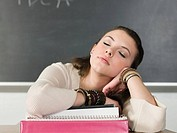 Girl sleeping in class