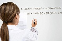 Scientist writing formula
