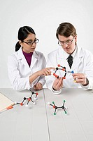 Scientists with molecule models