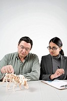 Scientists with model dinosaur (thumbnail)
