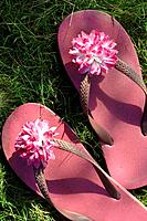 Pink flip flops with a blossom