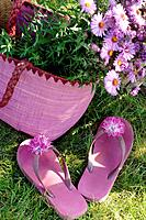 Pink flip flops with a blossom and flowers