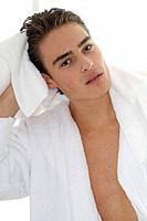 Man wearing bathrobe with towel