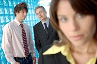 Businesswoman in office with colleagues in background