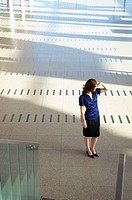 High angle view of a businesswoman shielding her eyes