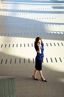 High angle view of a businesswoman talking on a mobile phone