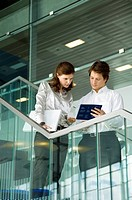 Businessman and a businesswoman looking at the documents