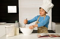 Boy making a cake