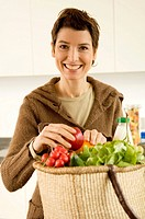 Portrait of a mid adult woman smiling in the kitchen (thumbnail)