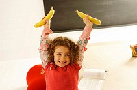 Girl holding two bananas