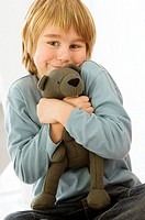 Portrait of a boy holding a teddy bear