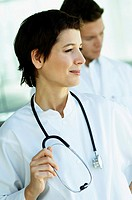 Close_up of a female doctor standing with a stethoscope around her neck