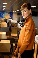Portrait of a female airline check_in attendant at an airport check_in counter