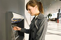 Side profile of a businesswoman using an ATM