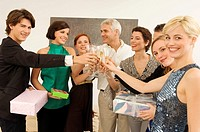 Group of people toasting with wine glasses in a party