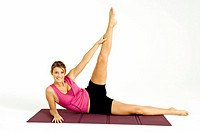 Portrait of a young woman exercising on an exercise mat