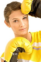 Portrait of a female boxer wearing boxing gloves