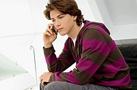 Close_up of a teenage boy talking on a mobile phone