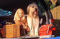 girl and Briard _ sitting in trunk