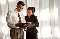 Smiling businesspeople with paperwork