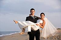 Happy newlyweds at beach