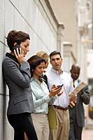 Businesspeople on cell phones